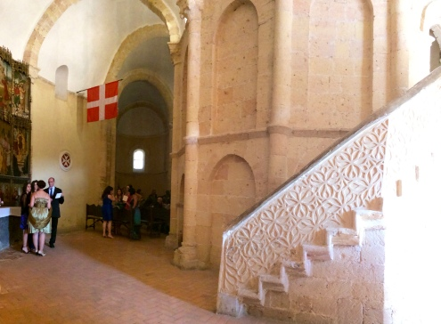 Detail of the stair to the upper level of the edículo, with the flags of the Order of Malta